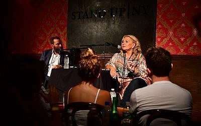 Rabbi Shmuley Boteach (l) and Roseanne Barr attend live podcast at Stand Up NY on July 26, 2018 in New York City.  (James Devaney/Getty Images via JTA)