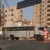 An Israeli military bus after it accidentally entered the Qalandiya refugee camp north of Jerusalem in the central West Bank on September 16, 2018. (Twitter)