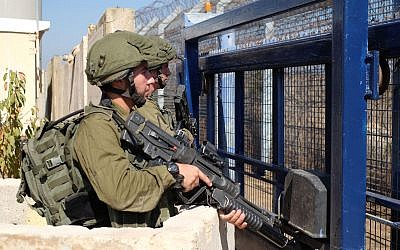 Israeli soldiers guard the Quneitra Crossing on the Syrian border with the Golan Heights on September 27, 2018. (Judah Ari Gross/Times of Israel)