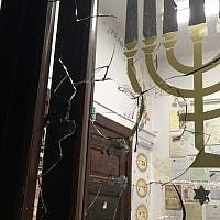 A broken window is seen at the New Synagogue in Gdansk, Poland, after a stone was thrown at it during Yom Kippur prayers on September 20, 2018. (GWŻ Gdańsk via World Jewish Congress)
