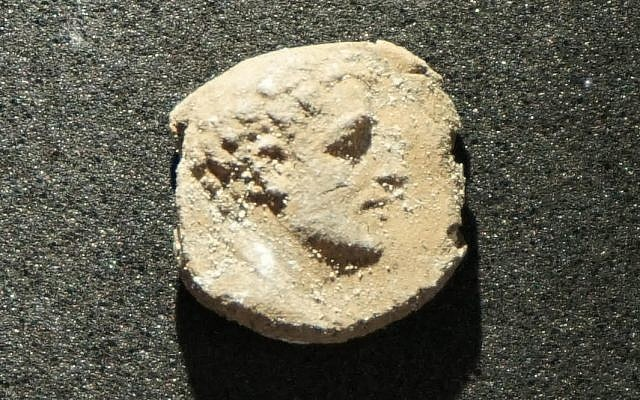 The clay impression of a face used to seal 2,000-year-old documents was discovered in August 2018 at the Maresha excavations as part of a trove of 1,020 sealings. (Asaf Stern)
