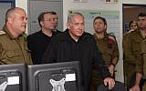 Prime Minister Benjamin Netanyahu at the headquarters of the IDF's Gaza Division on October 17, 2018. (Amos Ben Gershom/GPO)