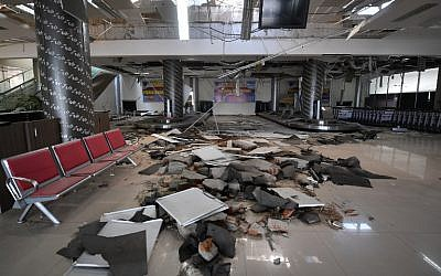 Damage to the Mutiara Sis Al Jufri airport is seen in Palu, in Indonesia's Central Sulawesi province, on September 30, 2018, following the deadly September 28 earthquake and tsunami. (AFP Photo/Adek Berry)