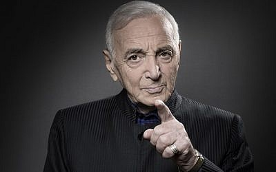 French-Armenian singer-songwriter Charles Aznavour poses during a photo session in Paris on November 16, 2017. (AFP PHOTO / JOEL SAGET)