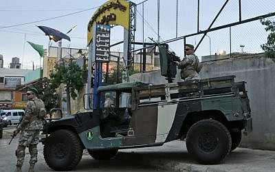 Lebanese security forces guard the entrance of Al-Ahed stadium in Beirut's southern suburbs during a tour organized by the Lebanese foreign minister for ambassadors on October 1, 2018, of alleged missile sites around the Lebanese capital in a bid to disprove Israeli accusations that the Hezbollah movement has secret missile facilities there. (AFP PHOTO / ANWAR AMRO)