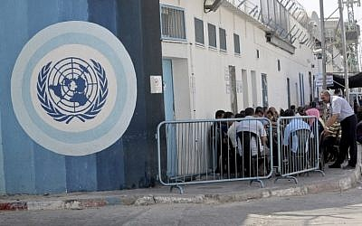 Palestinian employees of the United Nations Relief and Works Agency (UNRWA) take part in a sit in, in front of the agency's headquarters in Gaza City on October 2, 2018, to protest against job cuts announced by the UNRWA.  (AFP PHOTO / SAID KHATIB)