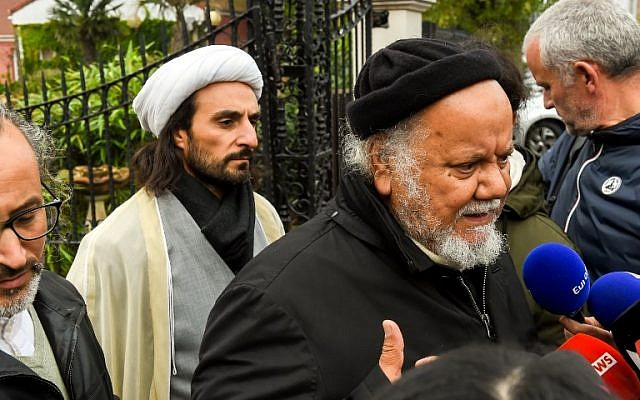 """Founder of the """"Centre Zahra France"""" religious association Gouasmi Yahia (R), flanked by Tahiri Jamel (L), head of the Centre, speaks to journalists outside the center, in Grande Synthe near Dunkirk on October 2, 2018 after a police operation. (AFP PHOTO / Philippe HUGUEN)"""