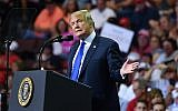 """US President Donald Trump speaks during a """"Make America Great Again"""" rally at Landers Center in Southaven, Mississippi, on October 2, 2018. (MANDEL NGAN/AFP)"""