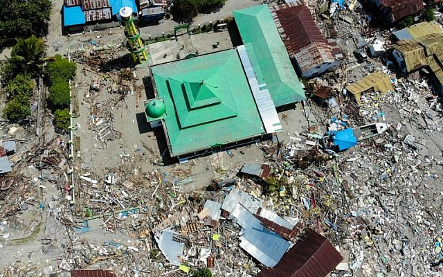 The devastation after tsunami waves swept through coastal houses and buildings in Wani, Indonesia's Central Sulawesi, seen in a aerial photograph taken on October 3, 2018. (JEWEL SAMAD/AFP)