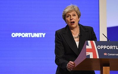 British Prime Minister Theresa May gives her keynote address on the fourth and final day of the Conservative Party Conference 2018 in Birmingham, central England, on October 3, 2018. (AFP Photo/Oli Scarff)