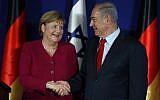 Prime Minister Benjamin Netanyahu (right) and German Chancellor Angela Merkel shake hands during a joint press conference at the King David Hotel in Jerusalem on October 4, 2018. (AFP Photo/Menahem Kahana)