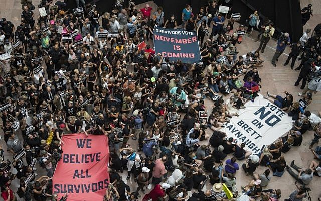 Protesters occupy the Senate Hart building during a rally against Supreme Court nominee Brett Kavanaugh on Capitol Hill in Washington, DC on October 4, 2018. (AFP / ANDREW CABALLERO-REYNOLDS)