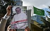 A protestor holds a picture of missing journalist Jamal Khashoggi during a demonstration in front of the Saudi Arabian consulate, on October 5, 2018 in Istanbul. (AFP PHOTO / OZAN KOSE)