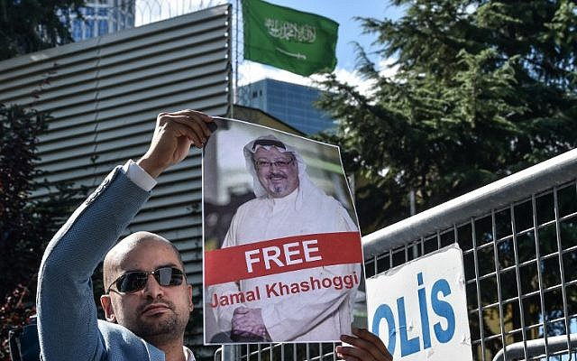 A protester holds a picture of Saudi journalist Jamal Khashoggi during a demonstration in front of the Saudi Arabian consulate in Istanbul on October 5, 2018. (AFP Photo/Ozan Kose)