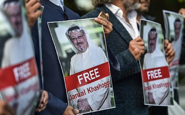 Protestors hold pictures of missing journalist Jamal Khashoggi during a demonstration in front of the Saudi Arabian consulate in Istanbul on October 5, 2018. (AFP/ OZAN KOSE)