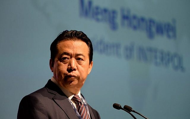 In this photo taken on July 4, 2017, Meng Hongwei, president of Interpol, gives an address at the opening of the Interpol World Congress in Singapore. (AFP Photo/Roslan Rahman)