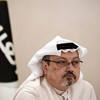 In this photo taken on December 15, 2014, Jamal Khashoggi looks on at a press conference in the Bahraini capital Manama. (AFP/Mohammed Al-Shaikh)