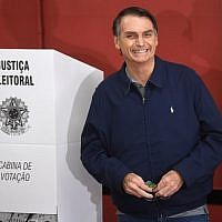 Brazil's right-wing presidential candidate for the Social Liberal Party (PSL) Jair Bolsonaro smiles after casting his vote during general elections, in Rio de Janeiro, Brazil, on October 7, 2018 (AFP PHOTO / Mauro Pimentel)