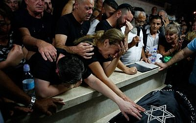 Mother Hava and relatives and friends mourn during the funeral of Kim Levengrond Yehezkel, aged 28, one of the two Israelis killed earlier in a terrorist attack, on October 7, 2018, in Rosh Haayin. (AFP PHOTO / Gil COHEN-MAGEN)