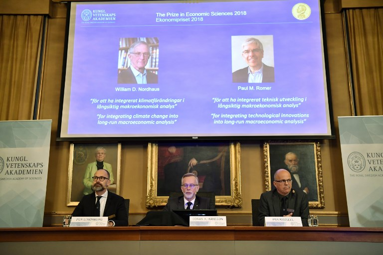 Per Stroemberg Goeran K Hansson and Per Krusell announce the laureates of the Nobel Prize in Economics during a press conference at The Royal Swedish Academy of Sciences in Stockholm