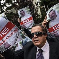 Protestors hold pictures of missing journalist Jamal Khashoggi during a demonstration in front of the Saudi Arabian consulate  in Istanbul, Turkey, on October 8, 2018. (OZAN KOSE/AFP)