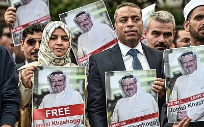 Protestors hold pictures of missing journalist Jamal Khashoggi during a demonstration in front of the Saudi Arabian consulate in Istanbul on October 8, 2018, in Istanbul. (AFP Photo/Ozan Kose)