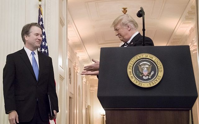 US President Donald Trump, right, gestures to Associate Justice of the US Supreme Court Brett Kavanaugh during a ceremonial swear-in at the White House in Washington, DC, on October 8, 2018. (AFP PHOTO / Jim WATSON)