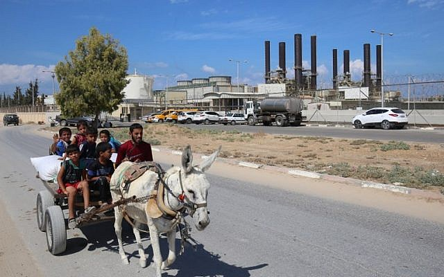 Palestinians ride a donkey near the Gaza power plant in Nuseirat, in the central Gaza Strip October 9, 2018. (AFP PHOTO / SAID KHATIB)