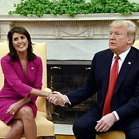 US President Donald Trump shakes hands with Nikki Haley, the United States ambassador to the United Nations, in the Oval Office at the White House on October 9, 2018. (AFP Photo/Olivier Douliery)