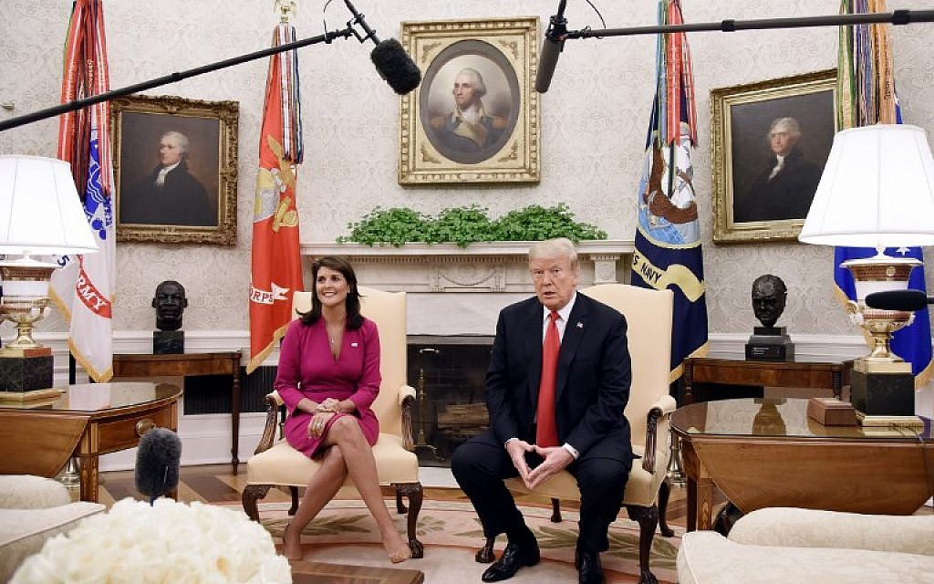 US President Donald Trump meets with Nikki Haley, the United States Ambassador to the United Nations in the Oval office of the White House on October 9, 2018 in Washington, DC. (AFP PHOTO / Olivier Douliery)