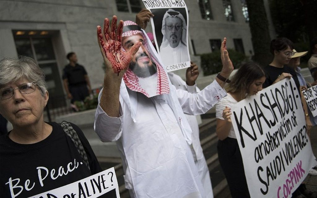A demonstrator dressed as Saudi Arabian Crown Prince Mohammed bin Salman (C) with blood on his hands protests outside the Saudi Embassy in Washington, DC, on October 8, 2018, demanding justice for missing Saudi journalist Jamal Khashoggi. (Jim Watson/AFP)