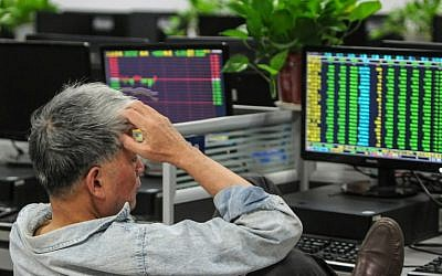 A investor monitors stock prices at a securities company in Jiujiang in China's central Jiangxi province on October 11, 2018 (Photo by STR / AFP) / China OUT