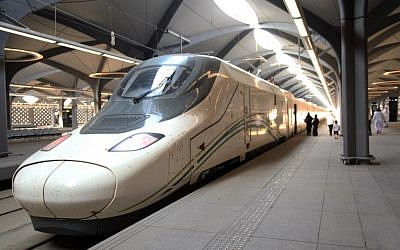 Saudi passengers walk on the platform at Mecca's train station on October 11, 2018 as the new high-speed railway line linking Mecca and Medina opens. (Bandar Aldandani/AFP)