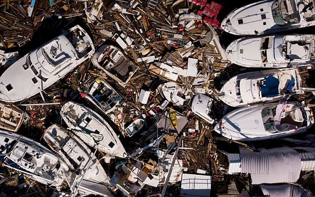 In this aerial view, storm damaged boats are seen in the aftermath of Hurricane Michael on October 11, 2018 in Panama City, Florida. (Photo by Brendan Smialowski / AFP)