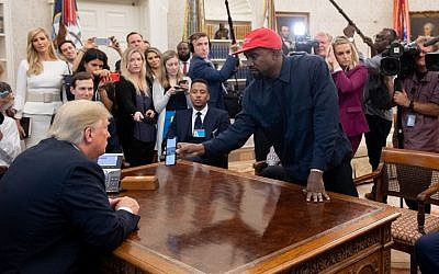 US President Donald Trump meets with rapper Kanye West, right, in the Oval Office of the White House in Washington, DC, on October 11, 2018. (Photo by SAUL LOEB / AFP)