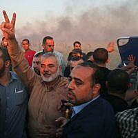 Gaza's Hamas leader Ismail Haniya flashes the V for victory sign at the Israel-Gaza border, east of Gaza city, on October 12, 2018. (Said Khatib/AFP)