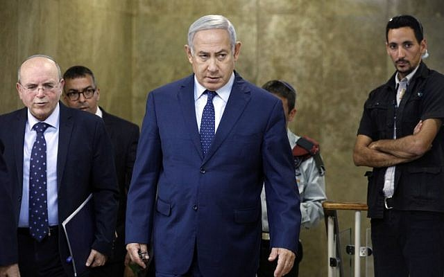 Prime Minister Benjamin Netanyahu arrives for the weekly cabinet meeting at the his office in Jerusalem on October 14, 2018. (Amir Cohen/Pool/AFP)