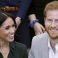 In this file photo taken on October 3, 2018 Britain's Prince Harry, Duke of Sussex (R) and Britain's Meghan, Duchess of Sussex (L) meet with young people on a visit to Joff Youth Centre in Peacehaven in East Sussex, southern England, on October 3, 2018 (Photo by Chris Jackson / POOL / AFP)
