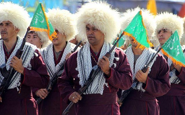 In this file photo taken on September 21, 2012, Turkmen Basij militiamen take part in an annual military parade marking the Iran-Iraq war, in the Iranian capital Tehran. (Atta Kenare/AFP)