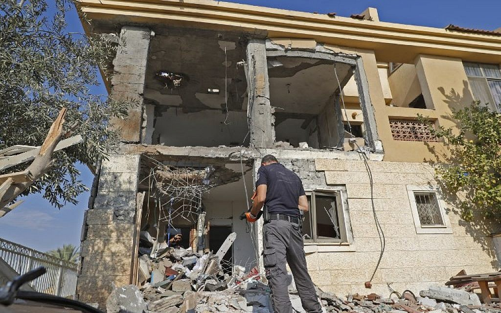 An Israeli sapper checks a house in the southern city of Beersheba after it was hit by a rocket fired from the Hamas-run Gaza Strip on October 17, 2018. (Jack Guez/AFP)