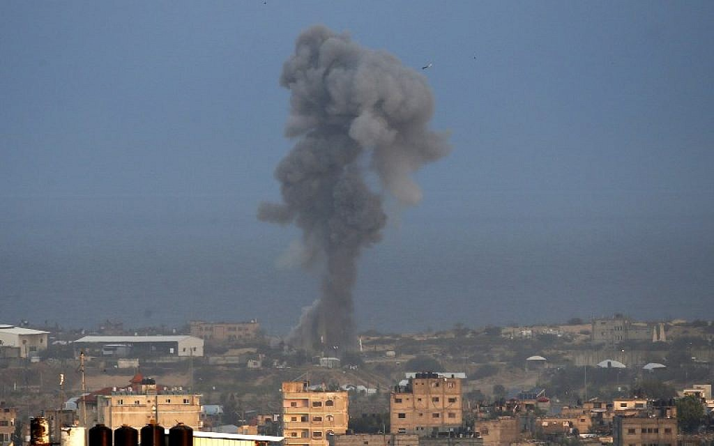 Smoke billows following an Israeli airstrike in the southern Gaza Strip city of Rafah on October 17, 2018. (Said Khatib/AFP)