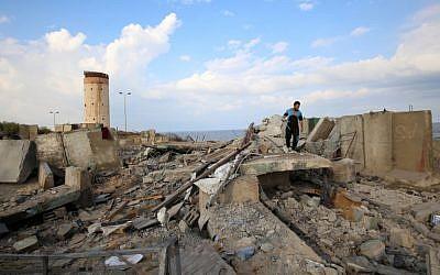 A Palestinian man walks on debris following a retaliatory Israeli air strike near the southern Gaza Strip city of Rafah after a rocket struck a home in the Israeli city of Beersheba on October 17, 2018. (SAID KHATIB / AFP)