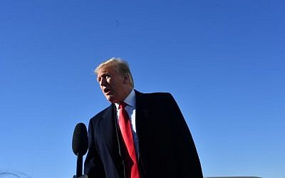 US President Donald Trump speaks to reporters before boarding Air Force One, as he departs from Joint Base Andrews, Maryland for a 3-day trip to hold campaign rallies in Montana, Arizona and Nevada. (Nicholas Kamm / AFP)