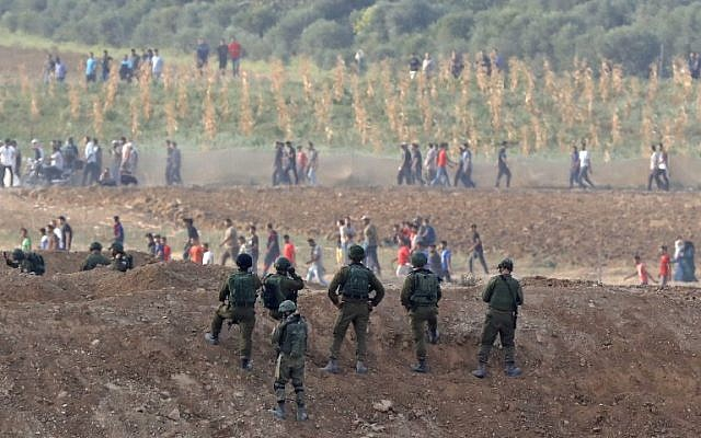 Israeli soldiers taking position during clashes with Palestinian protesters across the Gaza border on October 19, 2018 in Nahal Oz (Jack Guez/AFP)