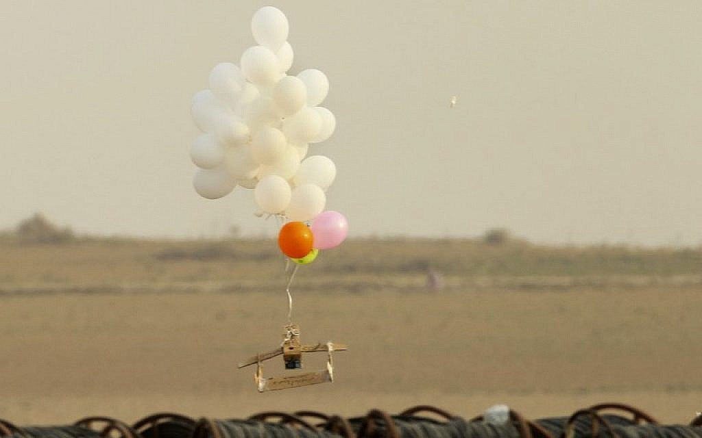 Illustrative. This picture taken on October 19, 2018 in Nahal Oz, from the Israeli side of the border with the northeast of the Gaza Strip, shows balloons carrying an alleged incendiary device launched by Palestinian protesters. (Photo by JACK GUEZ / AFP)