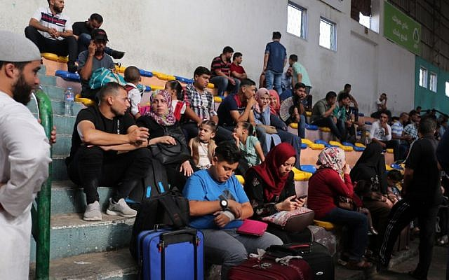 Palestinians wait to travel to Egypt through the Rafah border crossing in the southern Gaza Strip, on September 26, 2018. (Said Khatib/AFP)