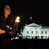 Members and supporters of the Jewish community come together for a candlelight vigil, in remembrance of those who died earlier in the day during a shooting at the Tree of Life Synagogue in the Squirrel Hill neighborhood of Pittsburgh, in front of the White House in Washington, DC on October 27, 2018. (ANDREW CABALLERO-REYNOLDS / AFP)