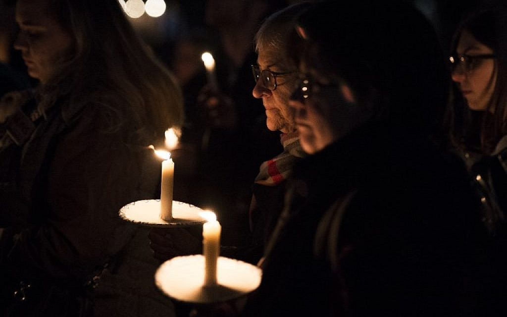 Members and supporters of the Jewish community come together for a candlelight vigil, in remembrance of those who died earlier in the day during a shooting at the Tree of Life Synagogue in the Squirrel Hill neighborhood of Pittsburgh, in front of the White House in Washington, DC on October 27, 2018. (Photo by ANDREW CABALLERO-REYNOLDS / AFP)