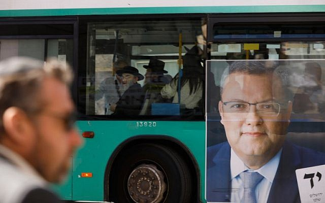 A picture taken on October 28, 2018, shows a campaign poster of municipal candidate Moshe Lion on a bus ahead of the upcoming Jerusalem municipal elections, in Jerusalem. (MENAHEM KAHANA / AFP)