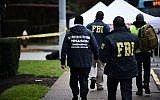 Members of the FBI and others survey the area on October 28, 2018 outside the Tree of Life Synagogue after a shooting there left 11 people dead in the Squirrel Hill neighborhood of Pittsburgh on October 27, 2018. (Photo by Brendan SMIALOWSKI / AFP)